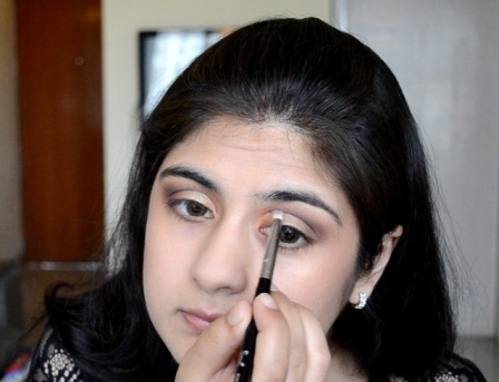How to apply makeup - Chic bronze and purple eye makeup 13